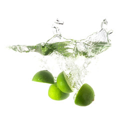 Limes splash on water, isolated on white background.