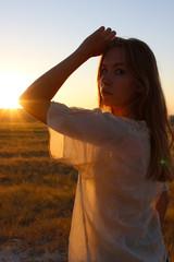 boho girl  in the rays of the setting sun