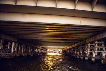 NETHERLANDS, AMSTERDAM - JANUARY 15, 2016: Bridge on river channel in January. Amsterdam - Netherlands.