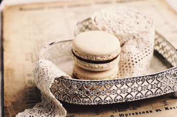 Vanilla macaroon with caramel filling at heart plate, retro style