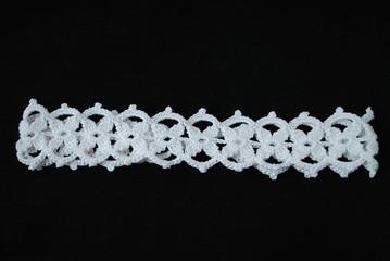 Crochet white headband from motifs.