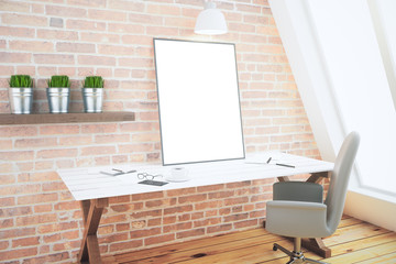 Loft interior with desk and blank picture frame, mock up