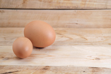 Eggs / Brown eggs placed on wooden floor.