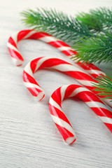 Lollipop candies with fir tree branches, closeup