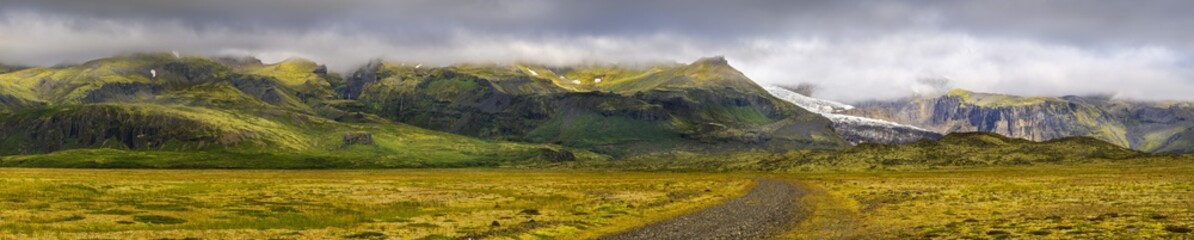stone road to volcanic hills in Iceland