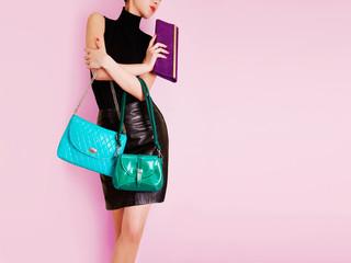 Woman with colorful bags. Shopping addicted. addiction.