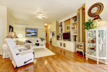 Amazing living room with white furniture and hard wood floor.