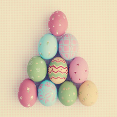 Vintage pastel easter eggs over checkered background