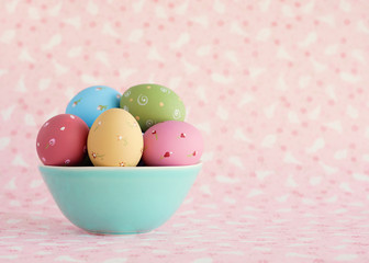 Vintage pastel easter eggs over flower patterned background