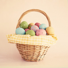 Pastel easter eggs in a basket