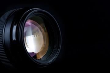 Professional camera photo lens isolated on black background