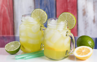 Glass jars filled with cold lemonade on USA national colors