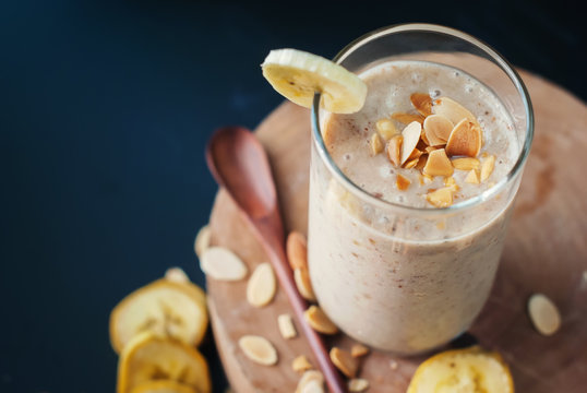 Fruit banana smoothies with milk, almond, flakes
