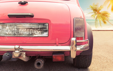 just married sign on classic vintage car. concept of love honeymoon in summer