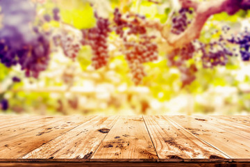 Wall Mural - Top of wood table with vineyard background - Empty ready for your product display montage.