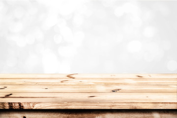 Wall Mural - Empty wood table ready for your product display montage. Abstract lights gray and white bokeh blurred background