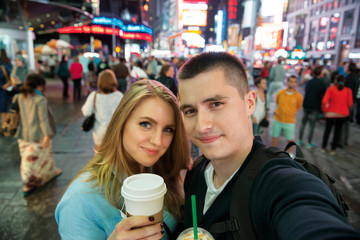 Happy couple traveling in New York city and drinking coffee