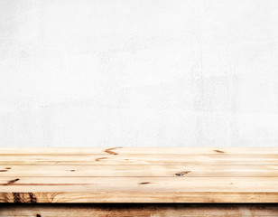 Wall Mural - Empty pine wood table top ready for your product display montage. with white wall background.
