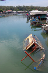 Abandoned sinked boat at river Thailand