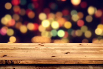 Wall Mural - Empty wooden table for product placement or montage with focus to the table top, blurred bokeh background .