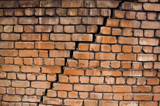 Large crack in the wall of  brick