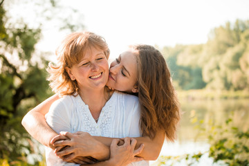 Happy together - mother and teenage daughter outdoor