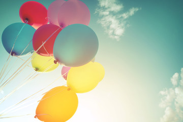 Multicolor balloons in summer holidays. Pastel color filter