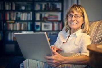 Happy woman using technology