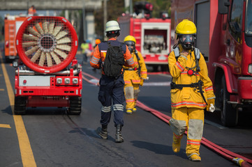 firefighter training with oxygen mask suit walk beside the anti anti bio hazard machine