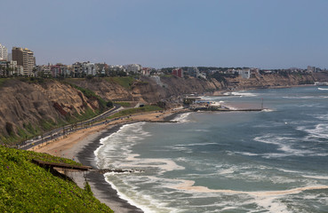 Pacific coast of Lima, Peru The high cliffs of the Pacific coast in Lima protect the city against tidal waves and tsunami