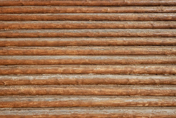Texture of wall made of old wooden logs