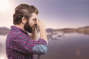 Composite image of side view of hipster taking photos with camera