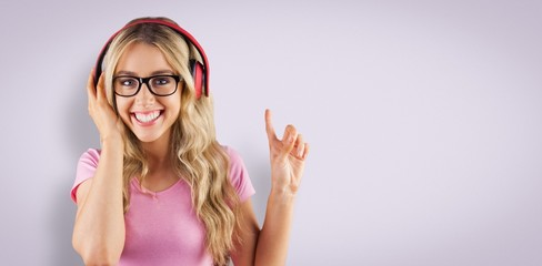 Composite image of portrait of a young hipster listening to music