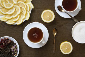 Tea with lemon on wooden board