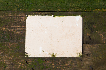 blank Rustic weathered beach warning sign on a wooden sea defence wall.