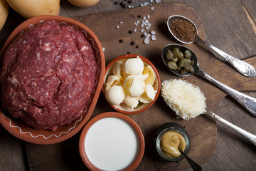 Set of ingredients for cooking on old wooden background
