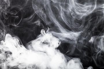 Smoke on a black background. Toned
