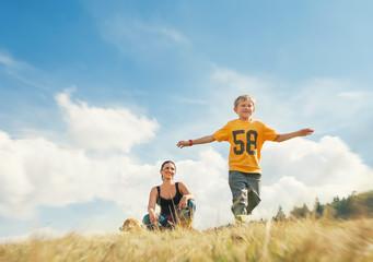 Wall Mural - Boy running on golden field