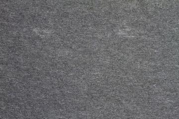 Black paper texture background.