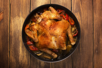 Whole baked chicken with spicy vegetables. Rustic style. Selective focus