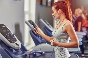 woman runing on a treadmill