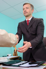 Man in office shaking hands