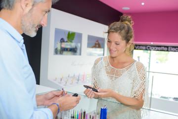 woman customer of e-cigarette shop