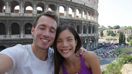 Aufkleber - Selfie - Romantic travel couple by Coliseum, Rome, Italy. Happy lovers on honeymoon sightseeing having fun in front of Colosseum. Woman and man in tourism travel concept.