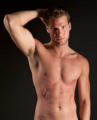 Attractive and Fit Shirtless Young Man
