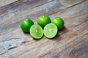 Lime on wooden background