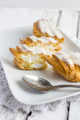 Dessert Eclair with whipped cream