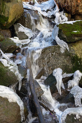 Stream of water during early spring with some ice left