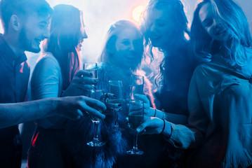 Friends partying at nightclub
