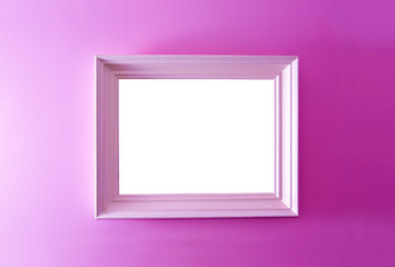 White empty frame on the pink wall.